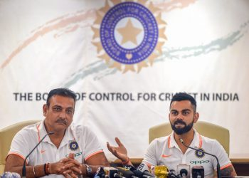 India head coach Ravi Shastri (L) and captain Virat Kohli address media persons in Mumbai Thursday before their departure for the Australia tour