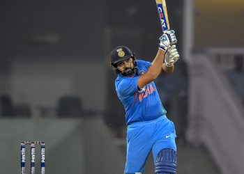 Rohit Sharma hits a six against West Indies in Lucknow