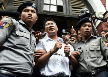 Reporters Wa Lone, pictured, and Kyaw Soe Oo, were arrested in Yangon in December 2017 and later sentenced to seven years in jail for violating the state secrets act, a charge supporters say is trumped up (AFP)