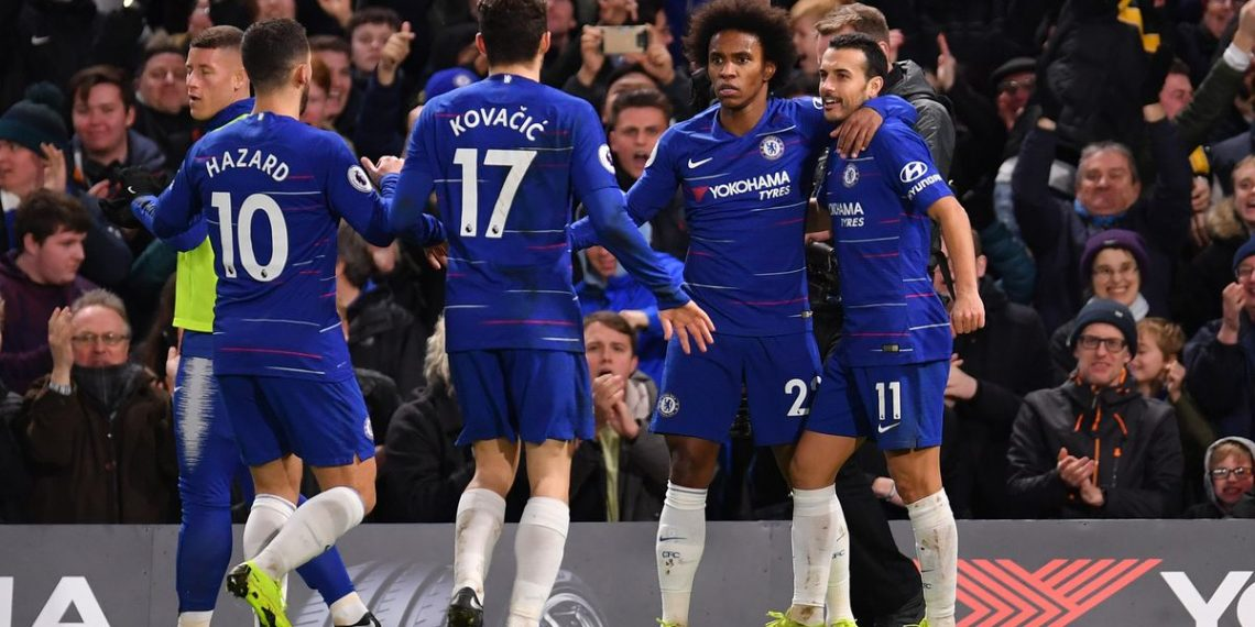 Chelsea goal scorers Pedro (No.11) and Willian rejoice after the former's goal against Newcastle United as teammates Eden Hazard and Mateo Kovacic come in to join them in celebration, Saturday