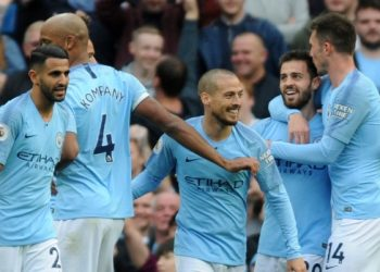 Manchester City players celebrate after scoring a goal against Burnley