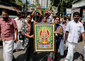 "Protesters hold a portrait of Hindu deity ""Ayappa"" as they take part in a rally called by various Hindu organisations after two women entered the Sabarimala temple, in Kochi, India, January 2, 2019. REUTERS/Sivaram V"