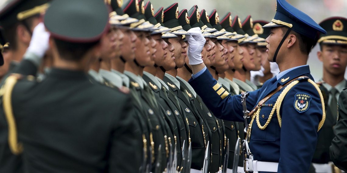 Chinese military officers use a piece of rope to line up honor guards as they prepare for a welcome ceremony for Greece's Prime Minister Antonis Samaras at the Great Hall of the People in Beijing Thursday, May 16, 2013. (AP)
