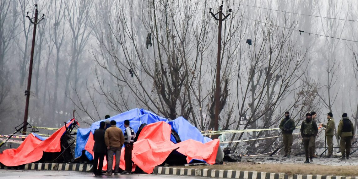 Lethpora: Security agencies inspect the site of suicide bomb attack at Lethpora area, in Pulwama district of south Kashmir, Friday, Feb. 15, 2019. At least 37 CRPF personnel were killed yesterday in one of the deadliest terror attacks in Jammu and Kashmir when a Jaish suicide bomber rammed a vehicle carrying over 100 kg of explosives into their bus in Pulwama district. (PTI Photo/S Irfan)(PTI2_15_2019_000036B)