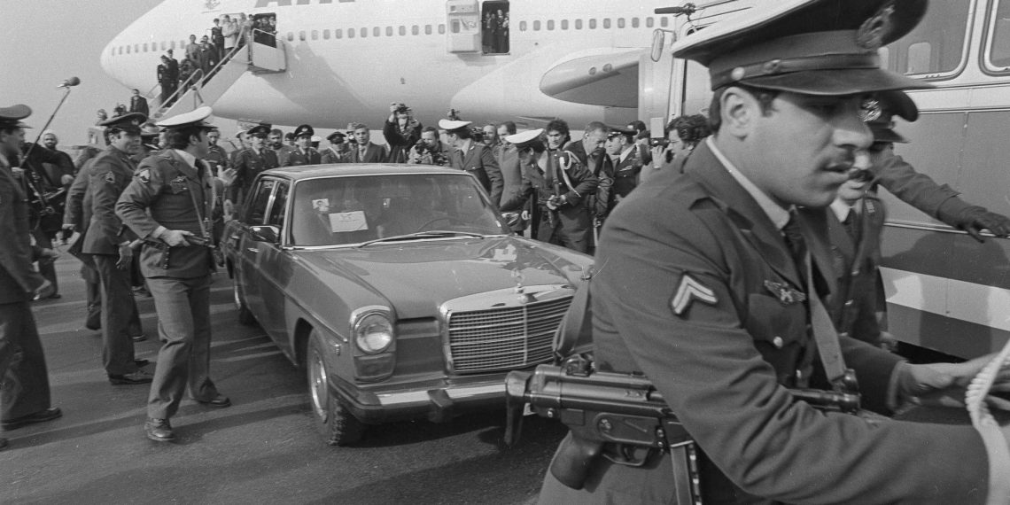 FILE - In this Feb. 1, 1979 file photo, Ayatollah Ruhollah Khomeini has a heavy escort as he enters car to leave the airport in Tehran, Iran. Forty years ago, Iran's ruling shah left his nation for the last time and an Islamic Revolution overthrew the vestiges of his caretaker government. The effects of the 1979 revolution, including the takeover of the U.S. Embassy in Tehran and ensuing hostage crisis, reverberate through decades of tense relations between Iran and America. (AP)