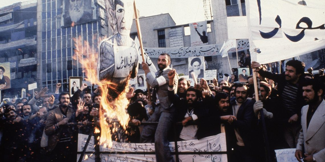FILE - In an undated photo from 1979, protestors burn an effigy of Shah Mohammad Reza Pahlavi during a demonstration in front of the U.S. Embassy in Tehran, Iran. Forty years ago, Iran's ruling shah left his nation for the last time and an Islamic Revolution overthrew the vestiges of his caretaker government. The effects of the 1979 revolution, including the takeover of the U.S. Embassy in Tehran and ensuing hostage crisis, reverberate through decades of tense relations between Iran and America. (AP)