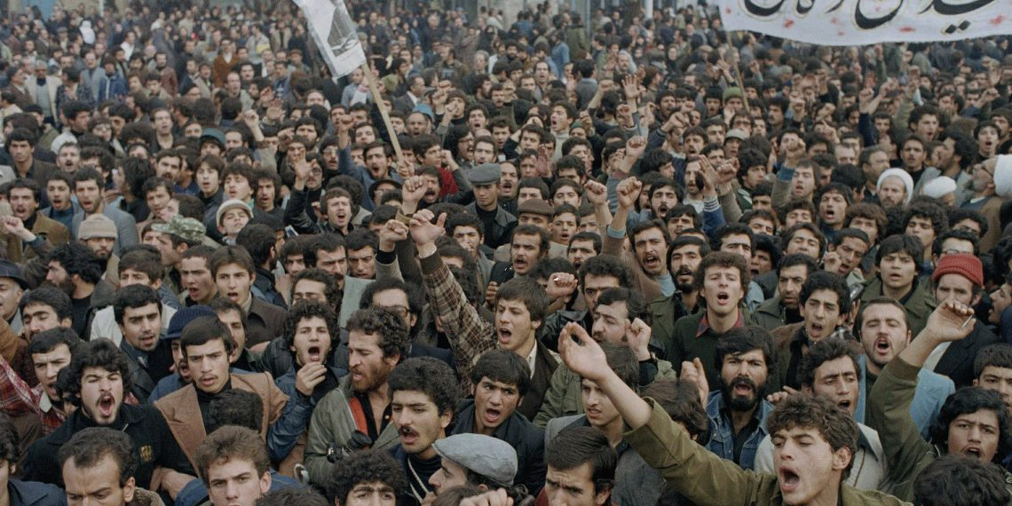 FILE - In this Oct. 9, 1978 file photo, demonstrators protest Shah Mohammad Reza Pahlavi in Tehran, Iran. Forty years ago, Iran's ruling shah left his nation for the last time and an Islamic Revolution overthrew the vestiges of his caretaker government. The effects of the 1979 revolution, including the takeover of the U.S. Embassy in Tehran and ensuing hostage crisis, reverberate through decades of tense relations between Iran and America. (AP)