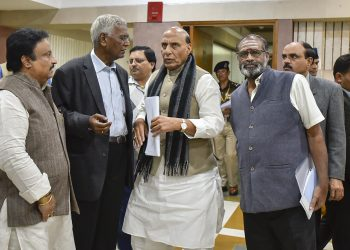 Home Minister Rajnath Singh talks with leaders of various political parties after the conclusion of the meeting, Saturday