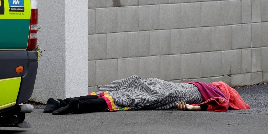 A body lies on the footpath outside a mosque in central Christchurch, New Zealand, on Friday (March 15 2019). A witness says many people have been killed in a mass shooting at a mosque in the New Zealand city of Christchurch. (Picture: Mark Baker/AP)