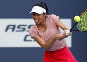 Hsieh Su-wei plays a backhand during her match against Naomi Osaka in Miami, Saturday