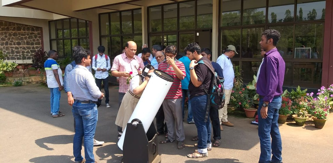 Students looking at 10 inch reflecting telescope at Institute of Physics in Bhubaneswar, Sunday