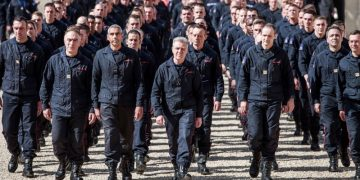 Firefighters and security forces who helped battle the flames at Notre Dame Cathedral arrive for a ceremony at the Elysee Palace in Paris, April 18, 2019. (AP photo)