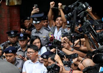 Detained Reuters journalists Wa Lone and Kyaw Soe Oo leave Insein court after listening to the verdict in Yangon. (Reuters photo)