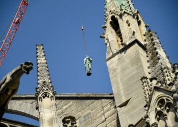 Tourists at the world-famous landmark were left stunned Thursday as the statues -- representing the 12 apostles and the four evangelists from the New Testament -- were lifted off the spire of the cathedral by crane. (Image: Yahoo)