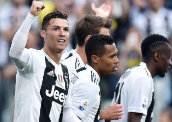 Cristiano Ronaldo (L) and other Juventus players celebrate after sealing their eighth Serie A title, Saturday