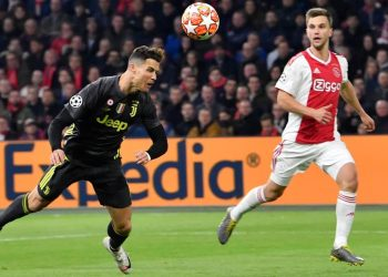 Cristiano Ronaldo of Juventus scores with a flying header as an Ajax Amsterdam defender watches him during the Champions League tie, Wednesday