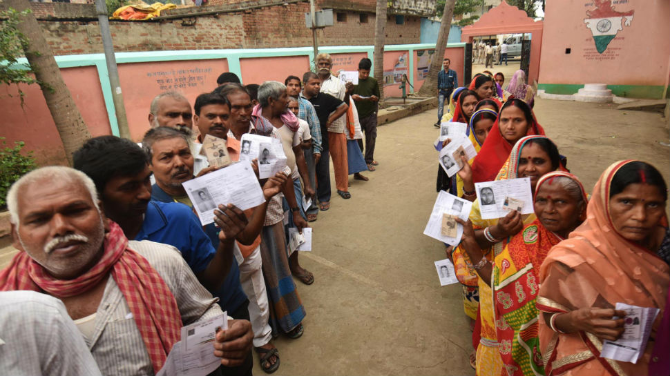 Voters stand in queue to cast their voters in Jharkhand