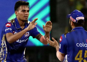 Rahul Chahar (L) celebrating with skipper Rohit Sharma
