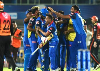 DC players celebrate following their victory.