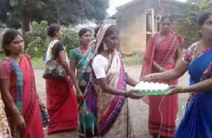 In this village, women throw eggs at temple for sons' long life